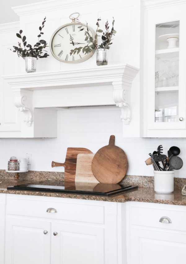 Create warmth in a white kitchen using cutting boards