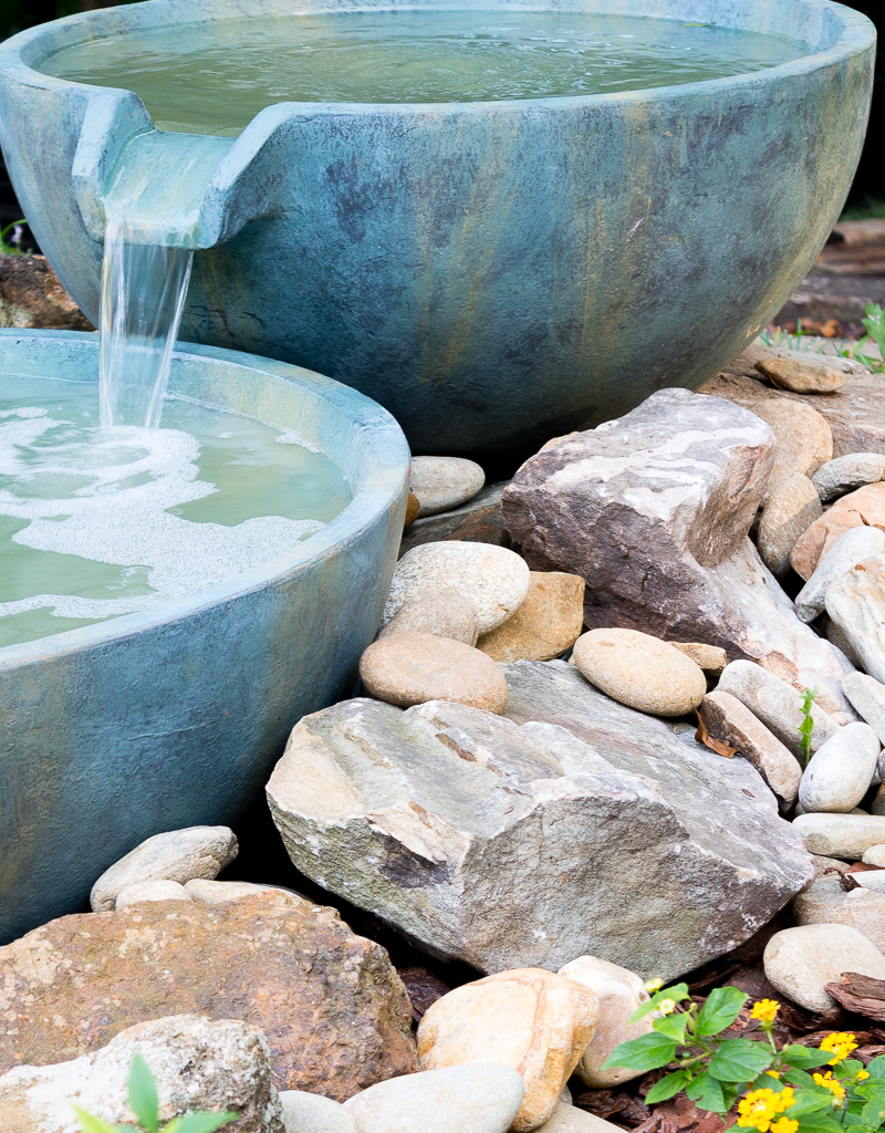 Spillway bowl and basin in a backyard pond